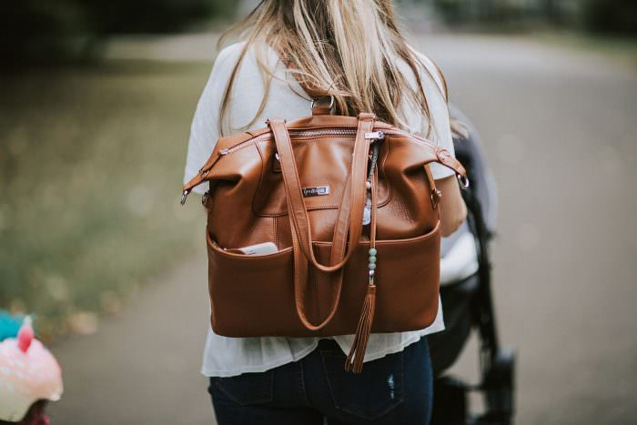 Motherhood blogger, Lynzy & Co. talks about her ultimate diaper bag essentials. Everything from diapers to toys, she tells you what you REALLY need!